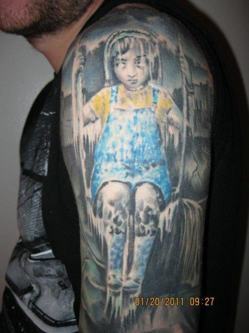 Horror movie themed colored frozen girl tattoo on upper arm