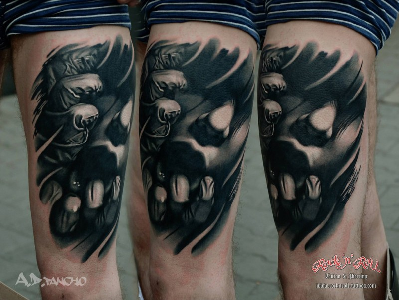 Horror style black and white thigh tattoo of woman portrait with hands