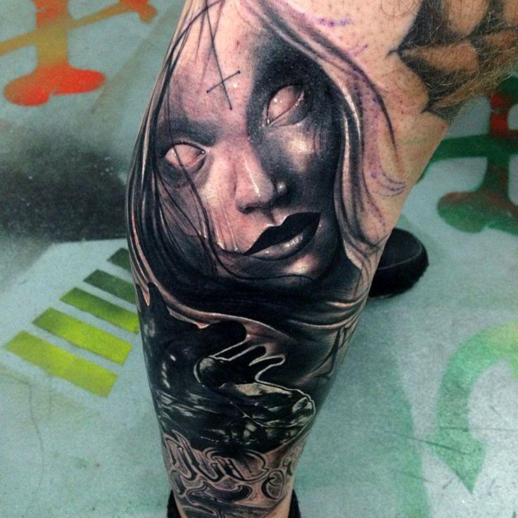 Horror style black ink leg tattoo of mystical woman portrait