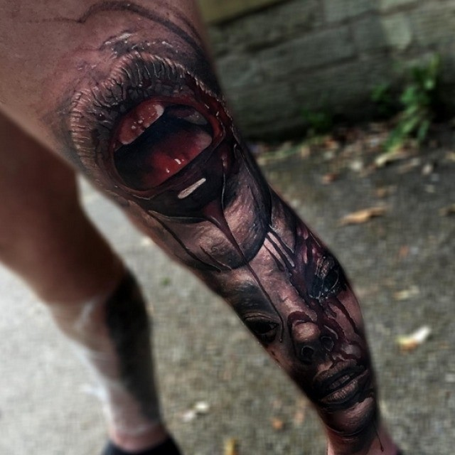 Horror style colored 3D bloody monster tattoo on whole leg