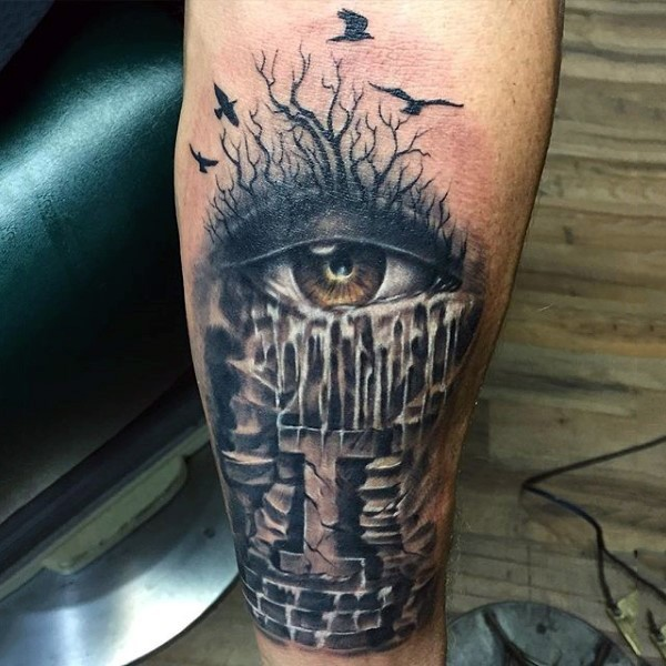 Horror style colored forearm tattoo of eye with flying birds
