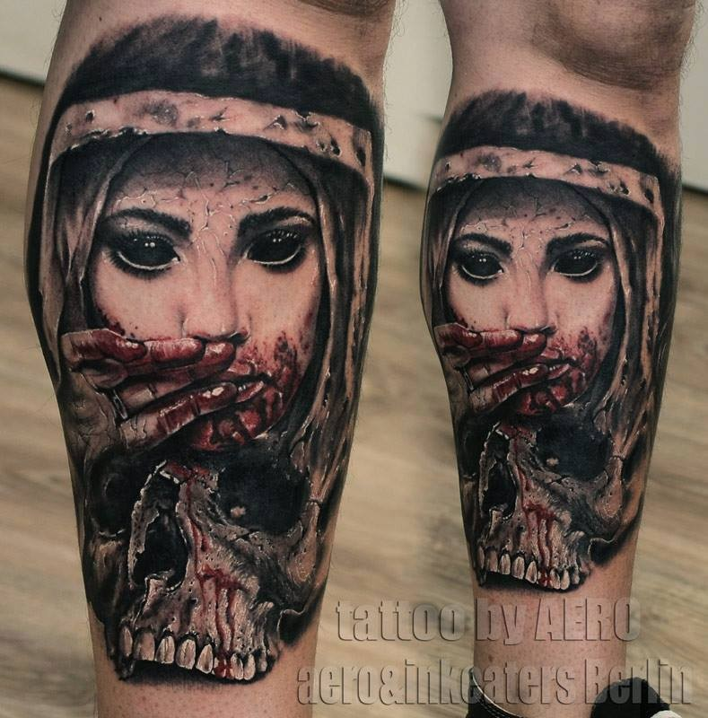 Horror style colored leg tattoo of demonic woman face with skull