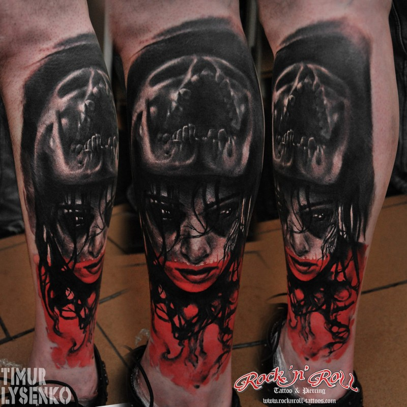 Horror style colored leg tattoo of demonic woman with screaming skull