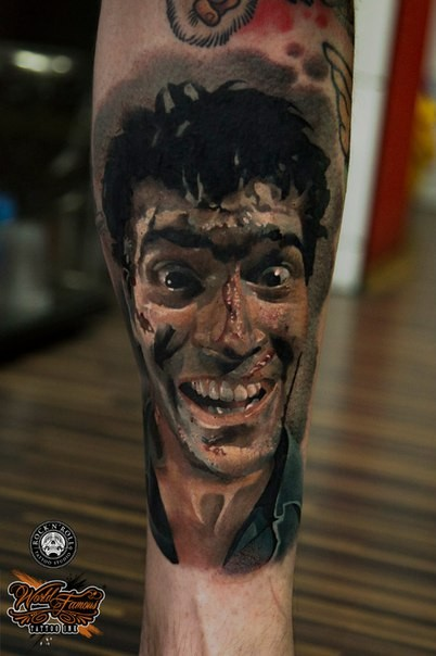 Horror style colored leg tattoo of man face with injuries