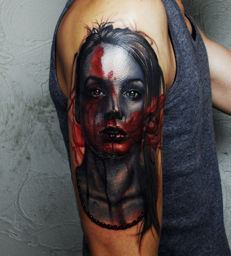 Horror style colored shoulder tattoo of woman face with blood
