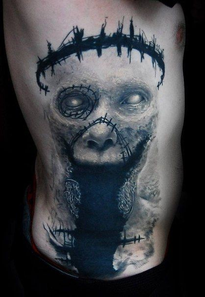 Horror style colored side tattoo of creepy monster face
