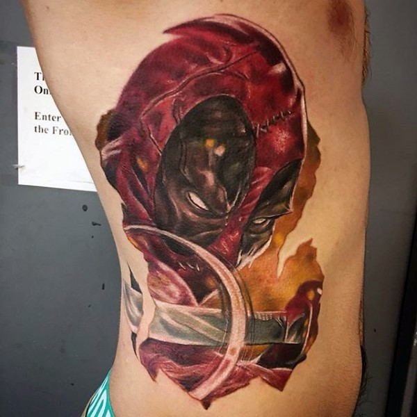 Horror style colored side tattoo of evil bloody Deadpool with sword