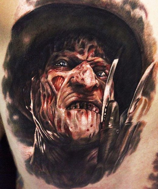 Horror style colored thigh tattoo of Freddy Kruger face