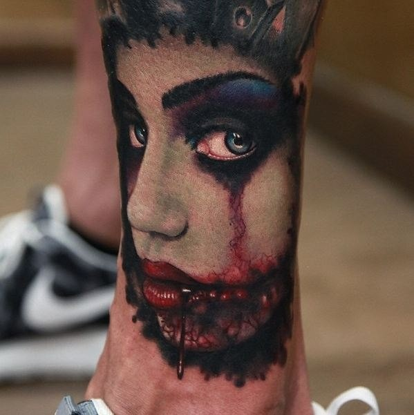 Horror style creepy looking arm tattoo of bloody monster woman