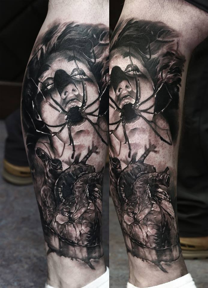 Horror style creepy looking leg tattoo of creepy woman with human heart