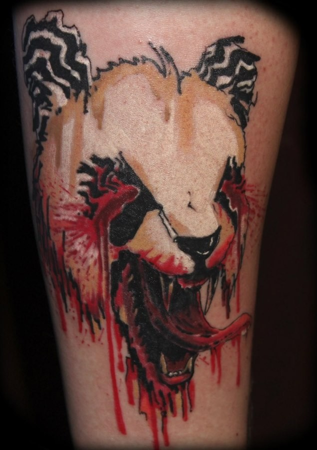 Horror style creepy looking leg tattoo of bloody panda bear head