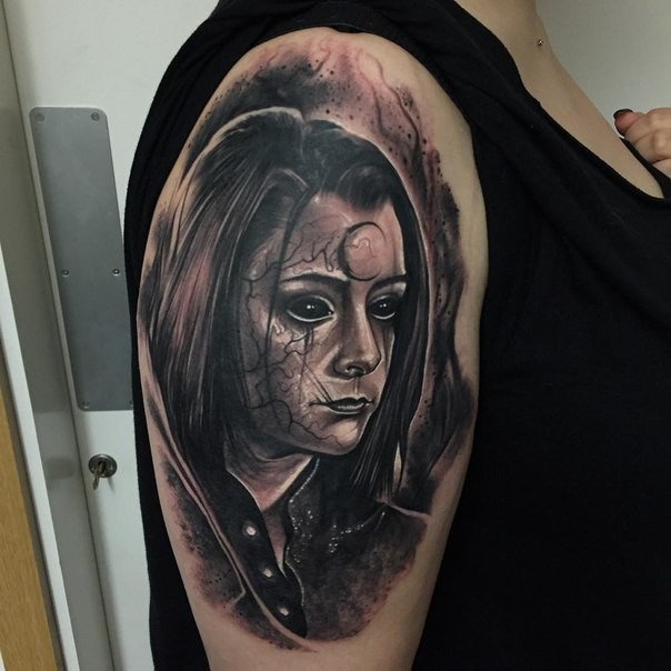 Horror style dark colored young girl&quots portrait with mystique symbol and veins on face shoulder tattoo