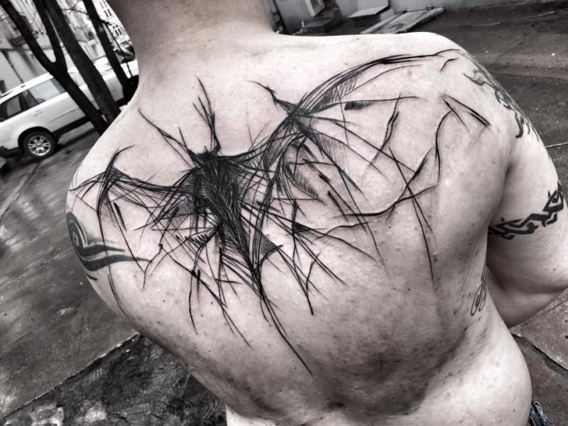 Horror style large black ink upper back tattoo of creepy bat