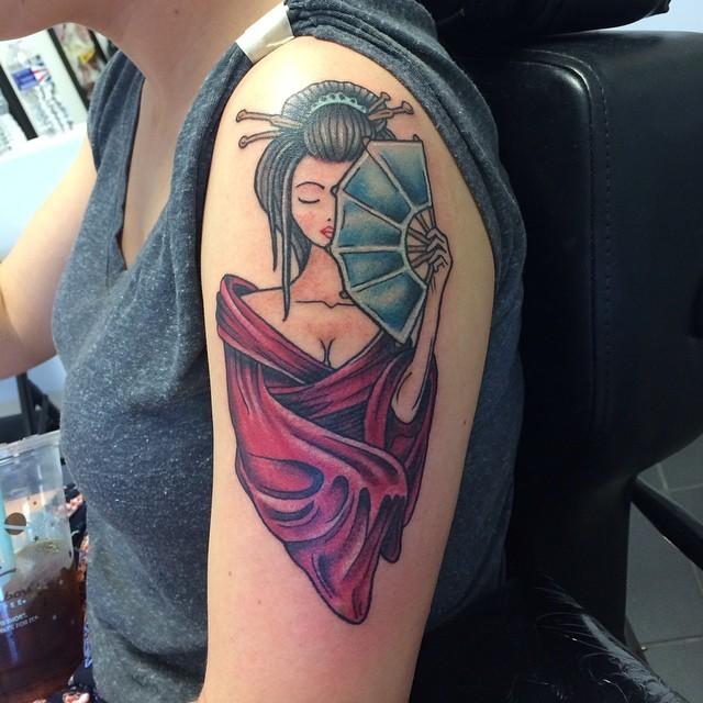 Hot seductive Asian Geisha in red kimono with hand fen shoulder tattoo