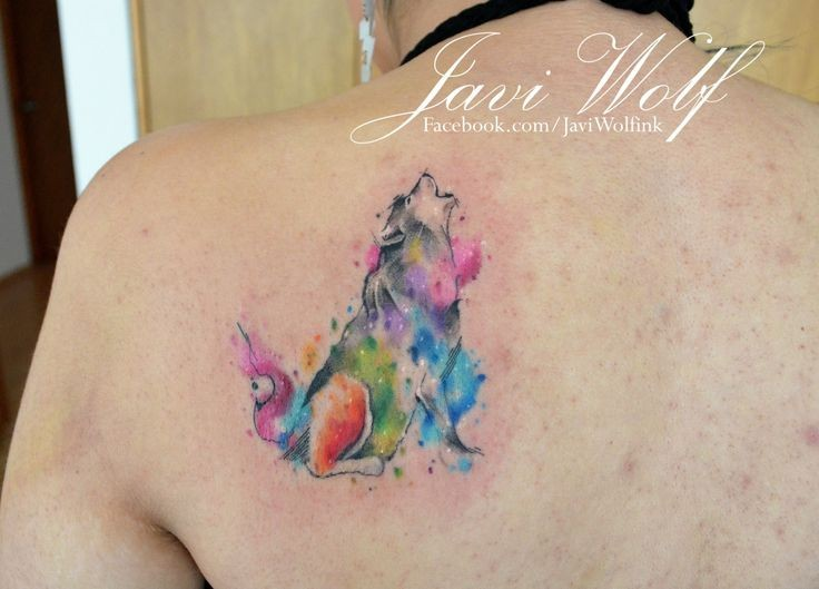 74c423835 Howling wolf colored tattoo on back by Javi Wolf in watercolor style ...