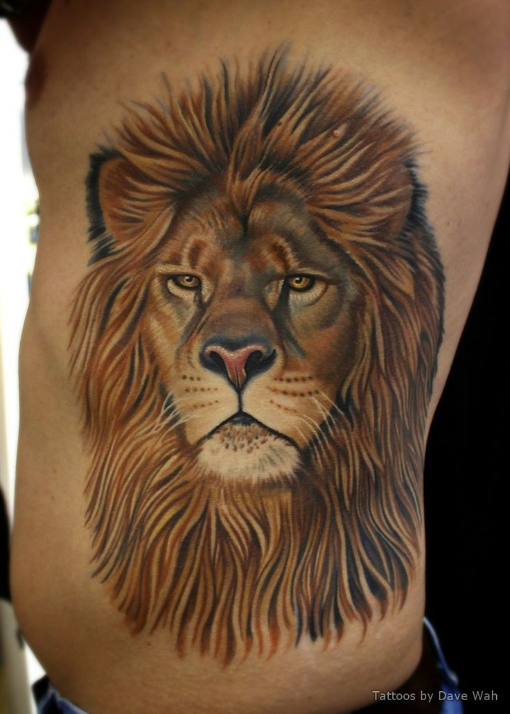 Huge lion face tattoo on ribs