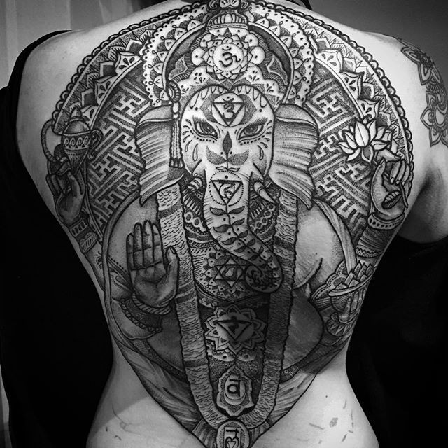 Huge super detailed Ganesha with lotus flower and special Hinduism symbols tattoo on whole back