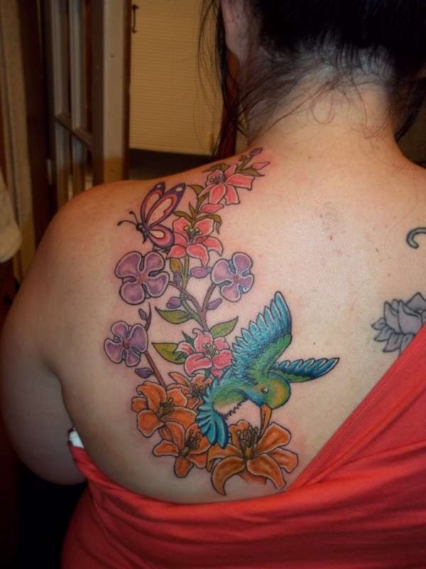 Colourful hummingbird tattoo for women