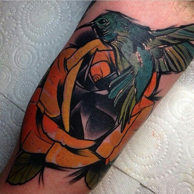 Hummingbird and rose flower colored tattoo in new school style