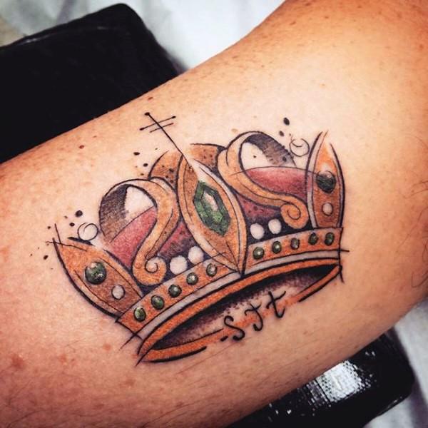 Illustrative style arm tattoo of big crown