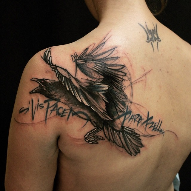Illustrative style black and white back tattoo of crow with lettering