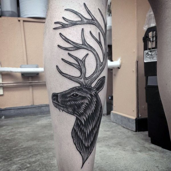 Illustrative style black ink leg tattoo of deer head
