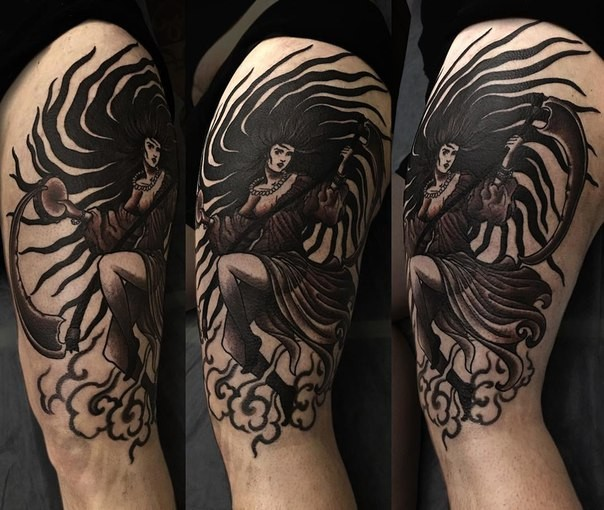 Illustrative style black ink shoulder tattoo of fantasy woman