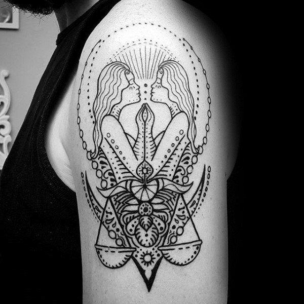 Illustrative style black ink shoulder tattoo of mirrored women with libra