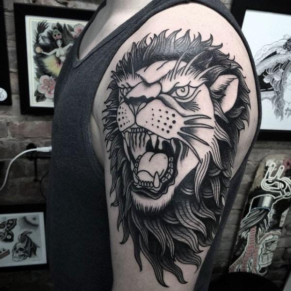 Illustrative style black ink shoulder tattoo of roaring lion