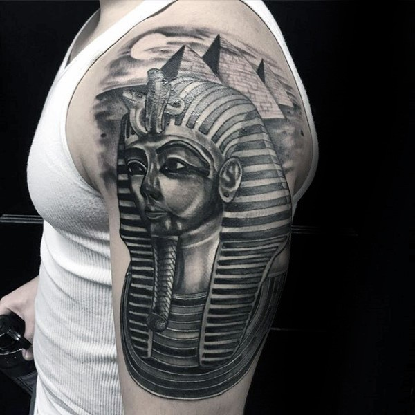 Illustrative style black shoulder tattoo of Egypt pharaoh statue and pyramids