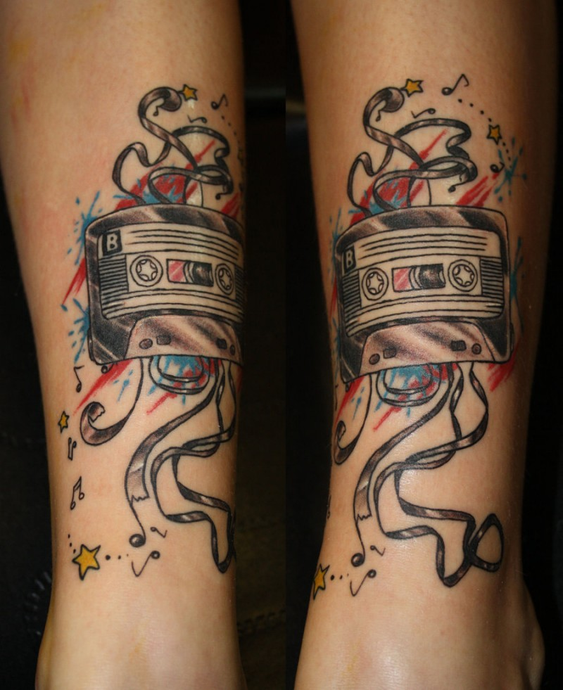 Illustrative style colored ankle tattoo of old music tape