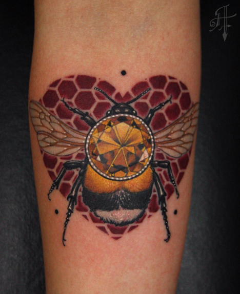 Illustrative style colored arm tattoo of bee with jewelry