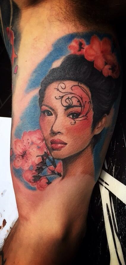 Illustrative style colored arm tattoo of Asian woman with flowers