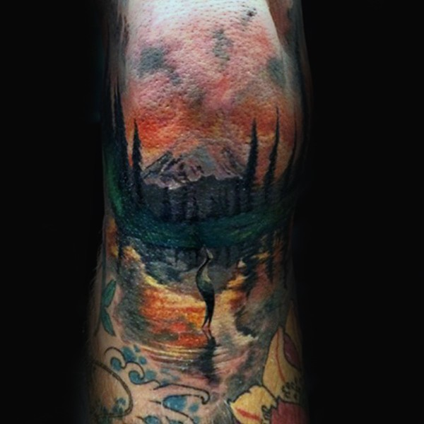 Illustrative style colored arm tattoo of mountain forest