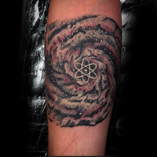 Illustrative style colored arm tattoo of atom and galaxy