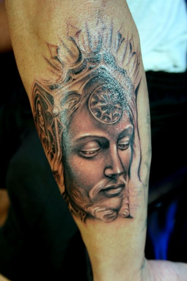 Illustrative style colored arm tattoo of fantasy man face