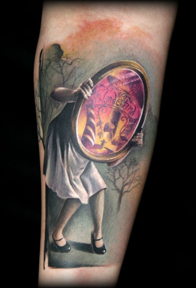 Illustrative style colored arm tattoo of creepy woman with mirror