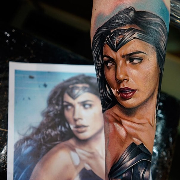 Illustrative style colored arm tattoo of beautiful Wonder woman