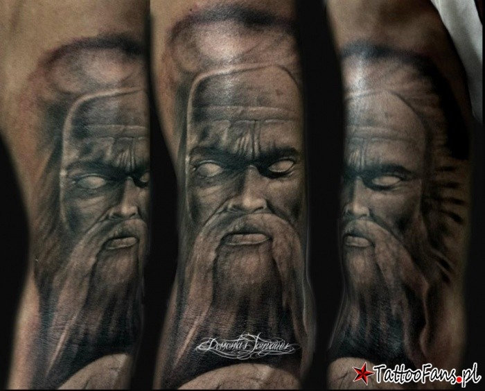 Illustrative style colored arm tattoo of mystical man face