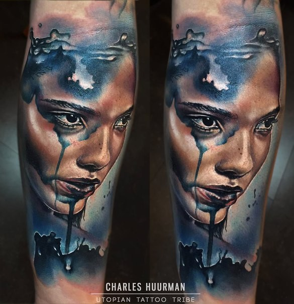 Illustrative style colored arm tattoo of woman portrait
