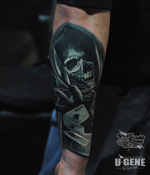 Illustrative style colored arm tattoo of Grimm reaper with cards