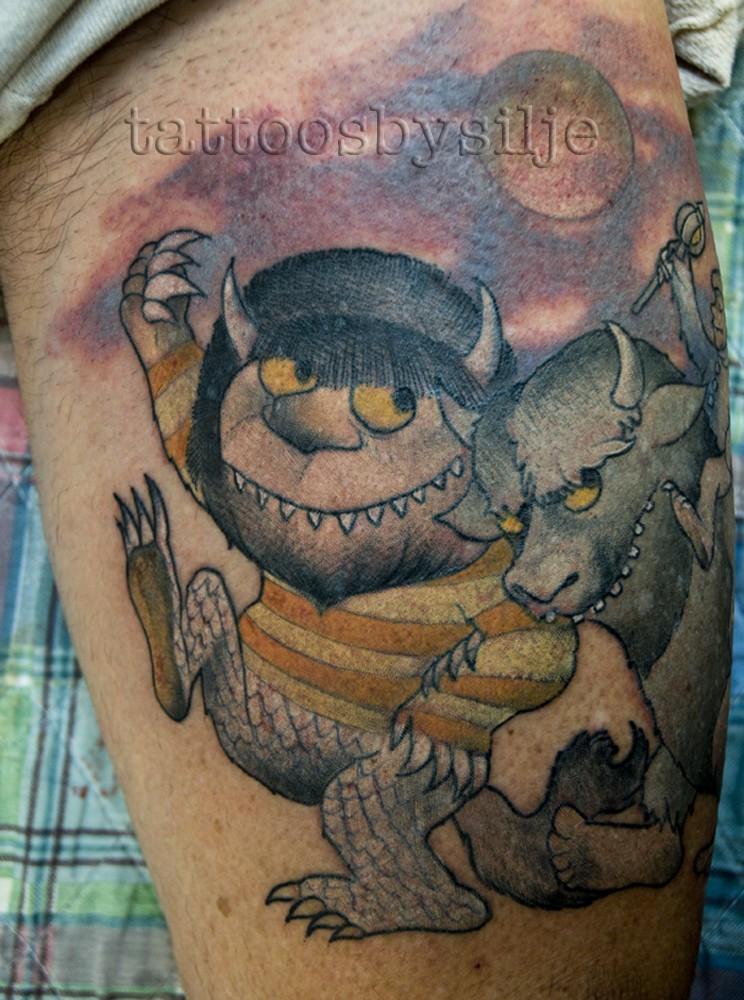 Illustrative style colored arm tattoo of fantasy animals