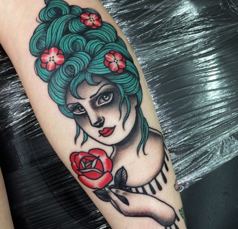 Illustrative style colored arm tattoo of beautiful woman with flowers