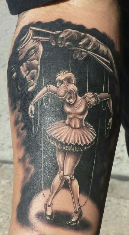 Illustrative style colored arm tattoo of dancing puppet