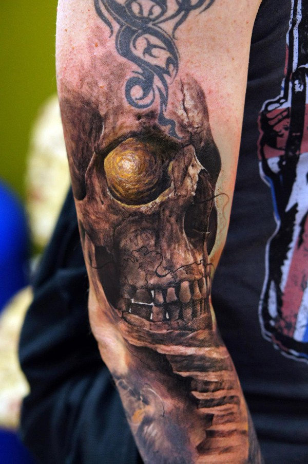 Illustrative style colored arm tattoo of human skull