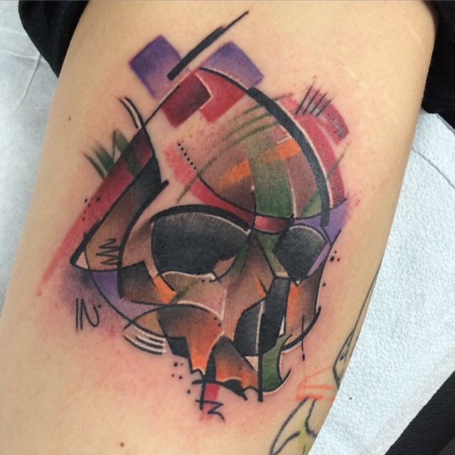 Illustrative style colored arm tattoo of human skull part