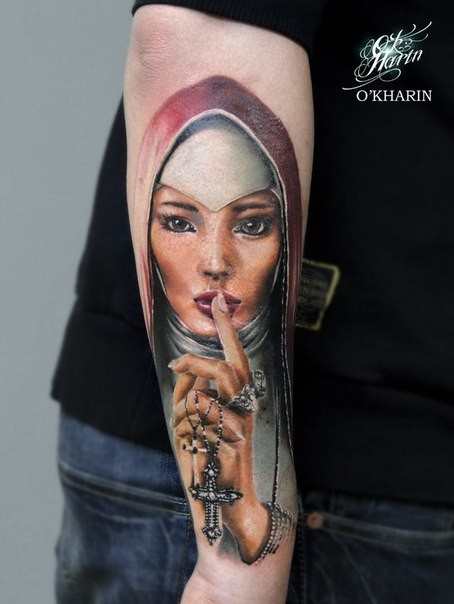 Illustrative style colored arm tattoo of beautiful saint woman with cross