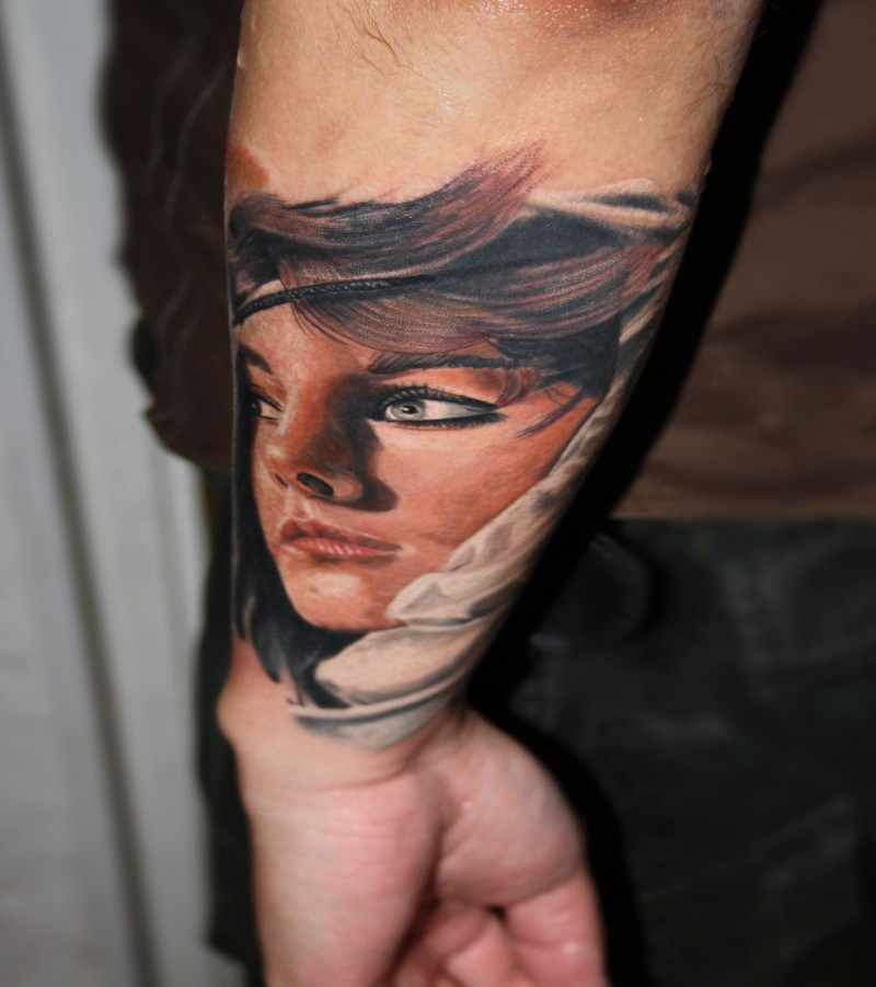 Illustrative style colored arm tattoo of beautiful woman face