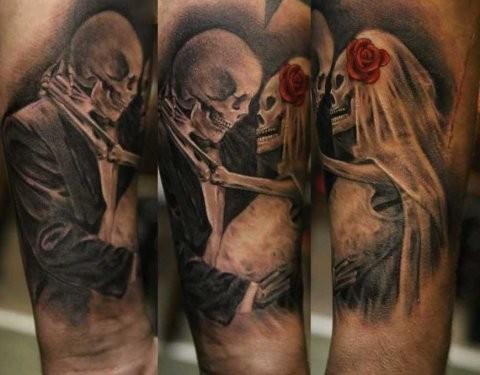 Illustrative style colored arm tattoo of skeleton wedding couple
