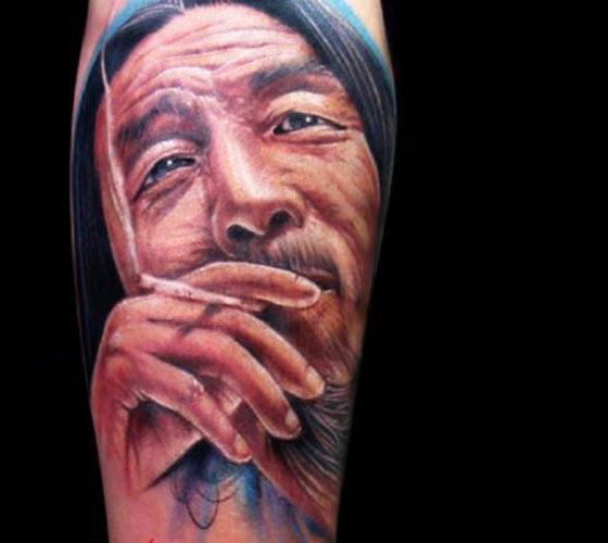 Illustrative style colored arm tattoo of smoking man portrait